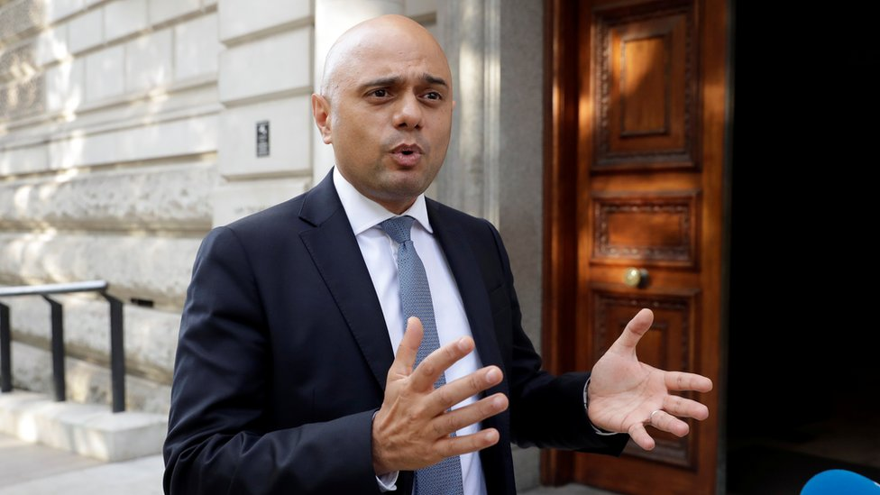 New Chancellor Sajid Javid outside the Treasury on his first day in the job