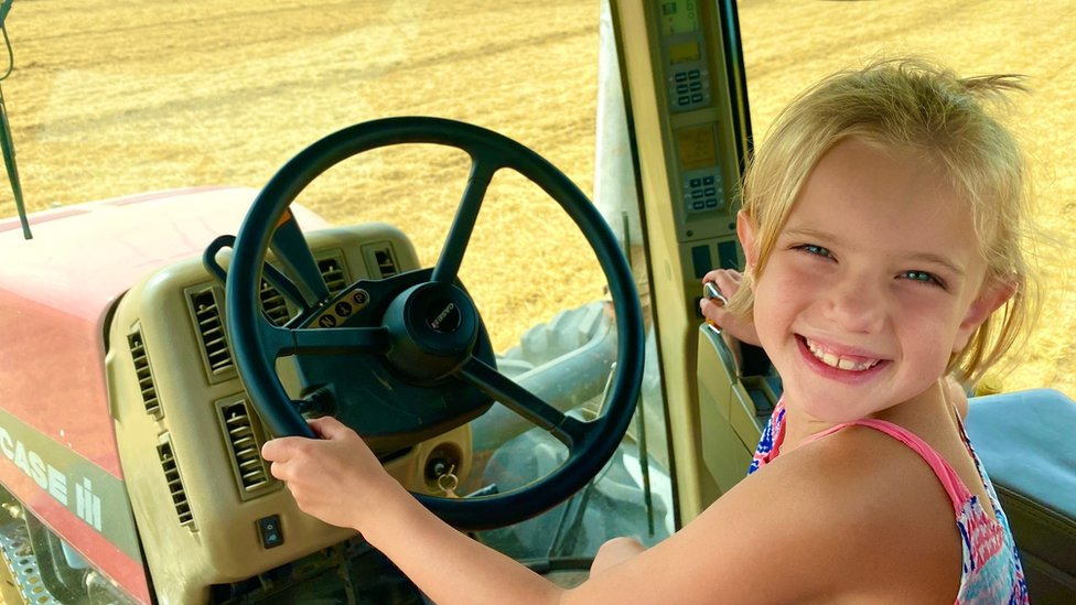 Katy Schultz's daughter drives a tractor