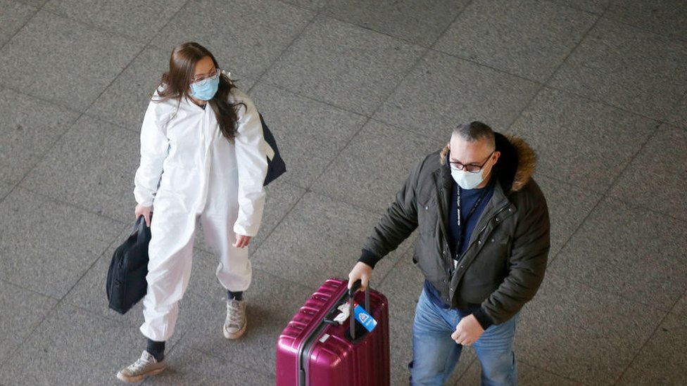 Travelers arrive at Heathrow Airport on January 17, 2021 in London.