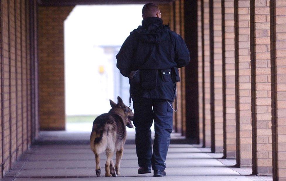 Prison dog and handler at Belmarsh Prison
