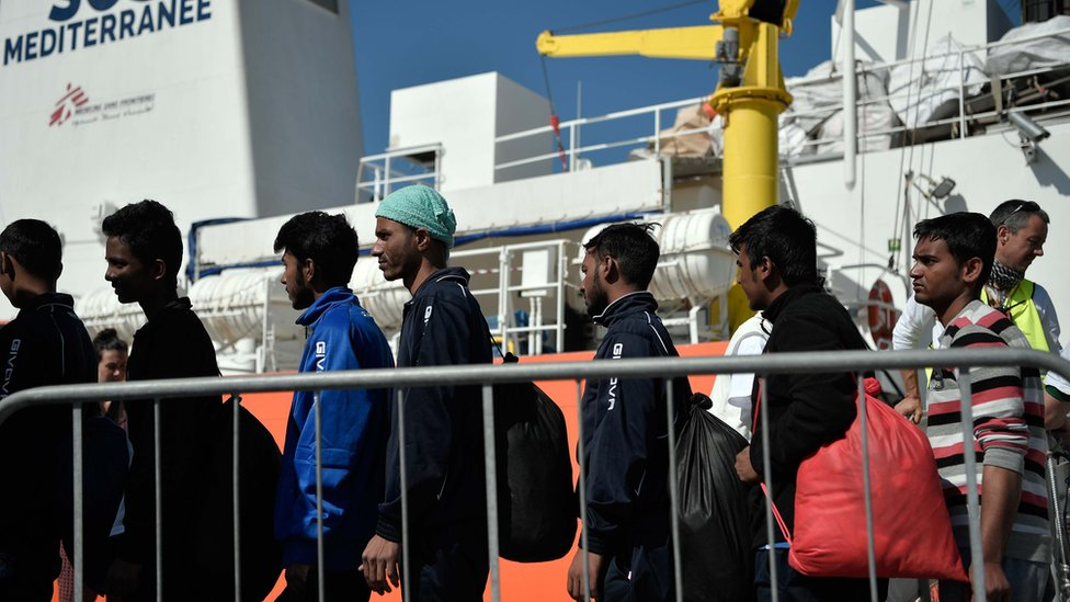 Migrants disembark at the port of Catania, Sicily on May 10, 2018