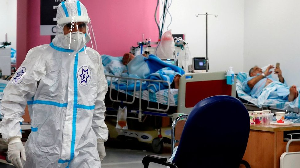 Medics wearing protective gear visit patients at the coronavirus ward of the Rambam Health Care Campus, in the northern Israeli city of Haifa (11 October 2020)