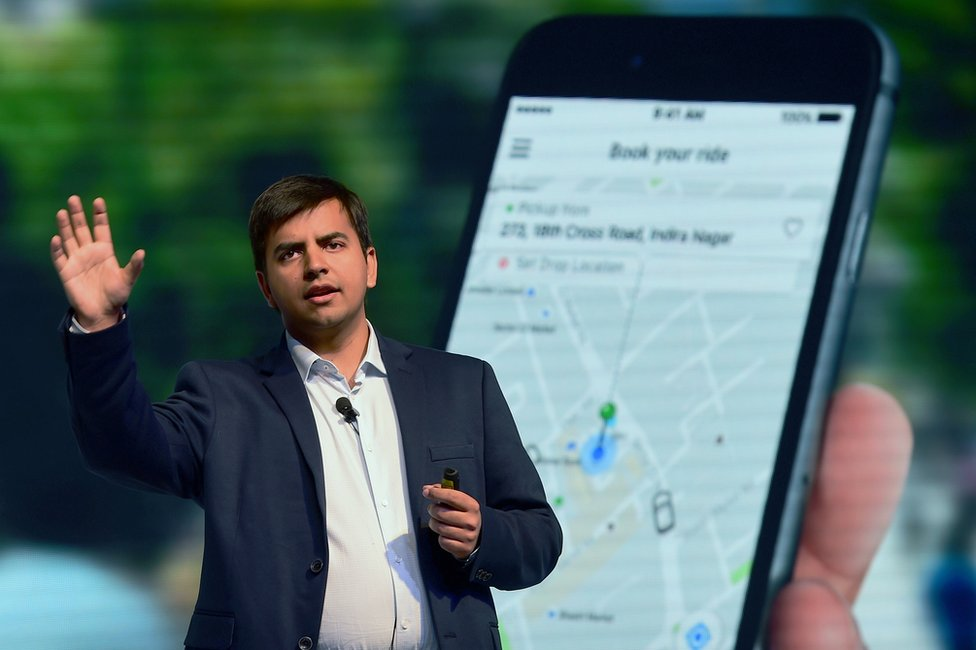Indian Ola app co-founder and CEO Bhavish Aggarwal gestures as he addresses a press conference in Bangalore on November 22, 2016.