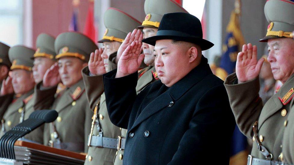 North Korean leader Kim Jong-un (2nd R) attending a military parade