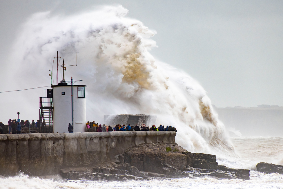 Waves crash against the harbour wall in Porthcawl, Wales