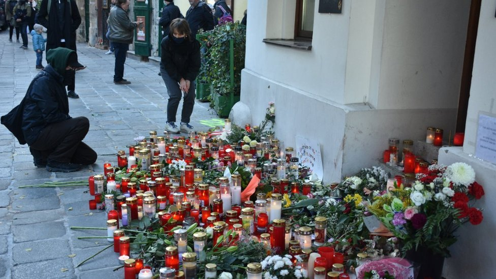 Flowers and candles are placed during a commemorative ceremony held on 5 Nov 2020 for four people killed in a terror attack in Vienna