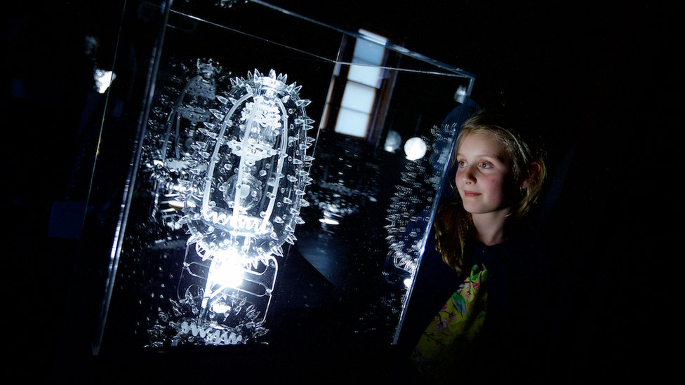 Girl looking at Luke Jerram sculpture at Brodie Castle