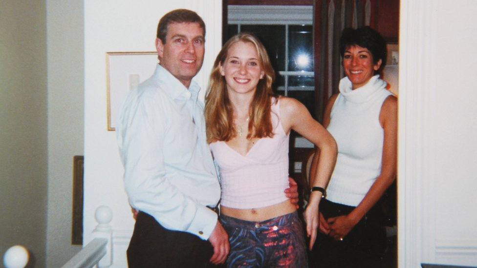 Prince Andrew with Virginia Giuffre, and Ghislaine Maxwell standing behind, in early 2001 (said to have been taken at Maxwell's London home)