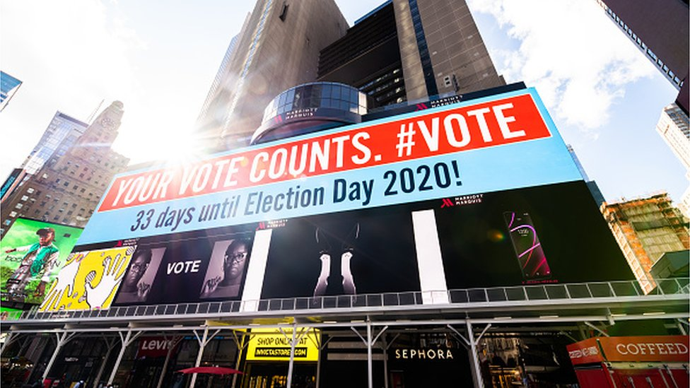 """A billboard that reads, """"your vote counts"""" is shown in Times Square on September 30, 2020 in New York City."""
