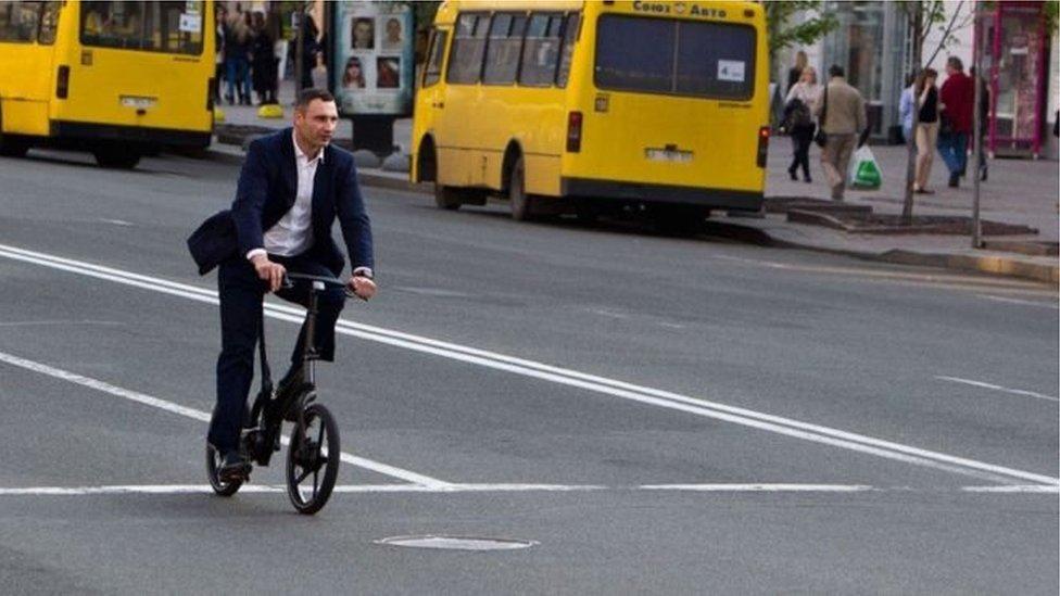 Vitaliy Klitschko's riding a bike.