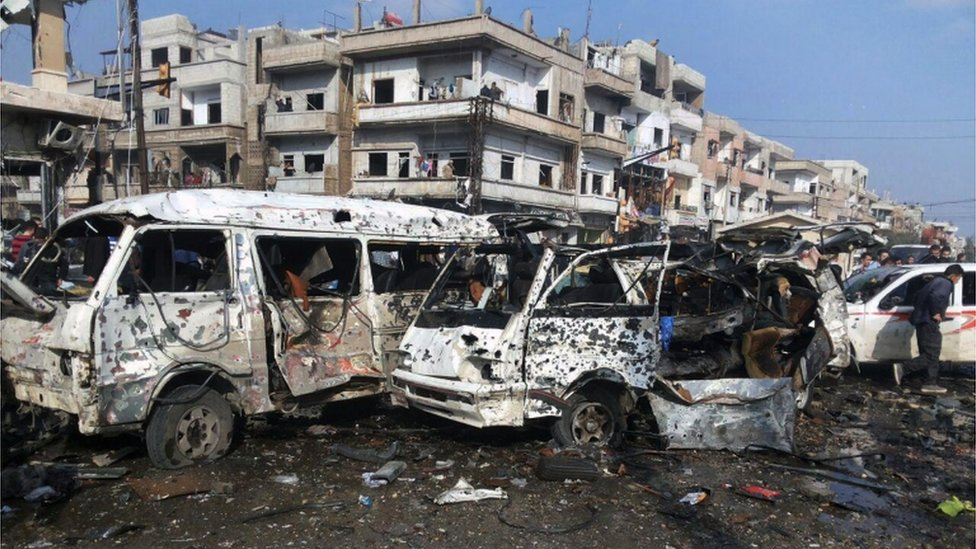 Images from Homs released by state media showed streets filled with debris and mangled cars