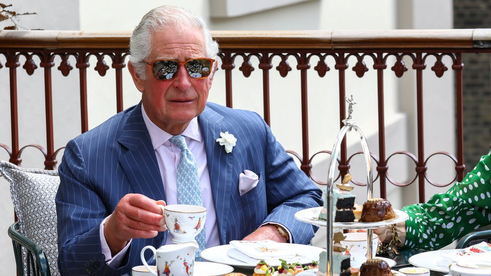 """Britain""""s Prince Charles drinks tea on the terrace during a visit to Theatre Royal in London,"""