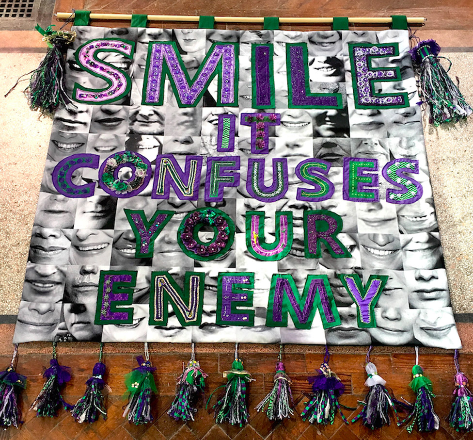 """""""Smile it confuses your enemy"""" banner by Junction Arts in Bolsover, Derbyshire, with textile artist Karina Thompson"""