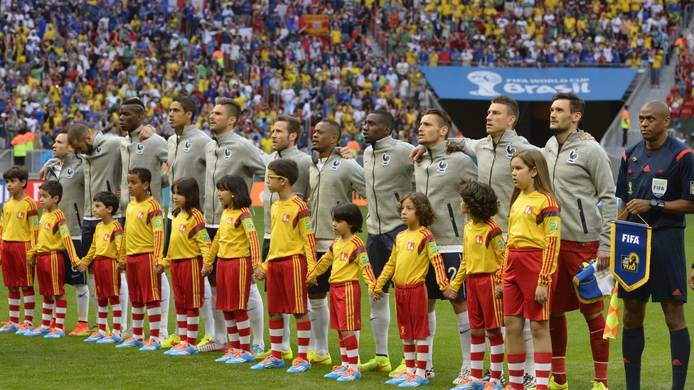France's squad listen to their national anthem before the match between France and Nigeria at the Mane Garrincha National Stadium in Brasilia during the 2014 FIFA World Cup on June