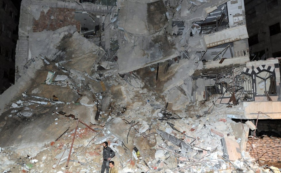 A residential seriously damaged after an air strike in the south of Jaramana city in the outskirts of Damascus, Syria, on 20 December, 2015