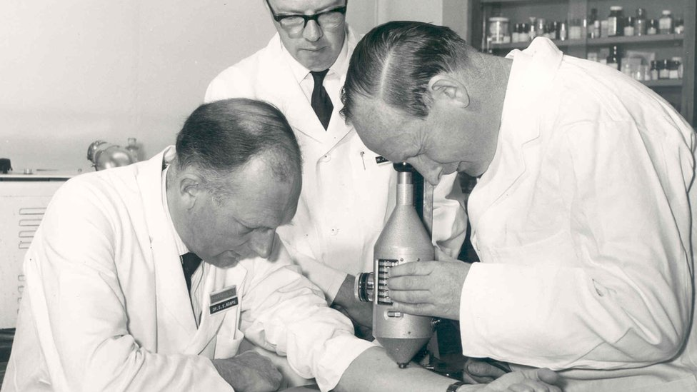 Dr Stewart Adams, Dr John Nicholson and Mr R Cobb studying degrees of inflammation using a colour intensity measuring device