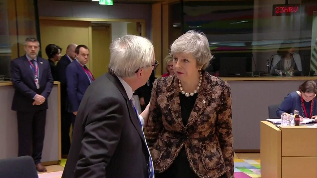May and Juncker share quiet Brexit word at EU summit