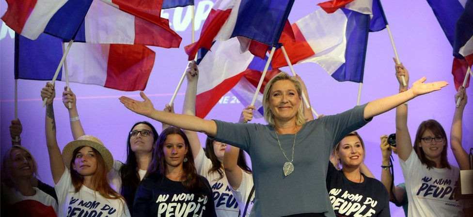 France's far-right National Front president Marine Le Pen waves to supporters during a summer meeting in Frejus, southern France in September 2016