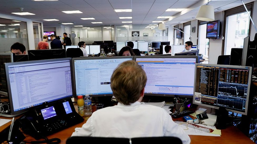 A trader watches his monitor