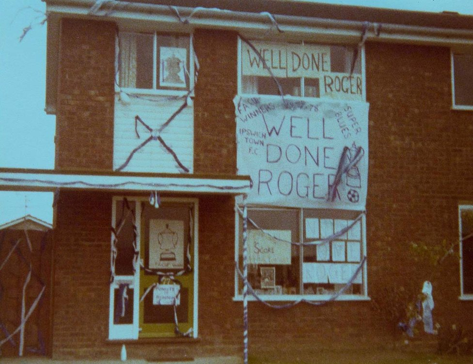 Roger Osborne's house draped in ribbons and banners