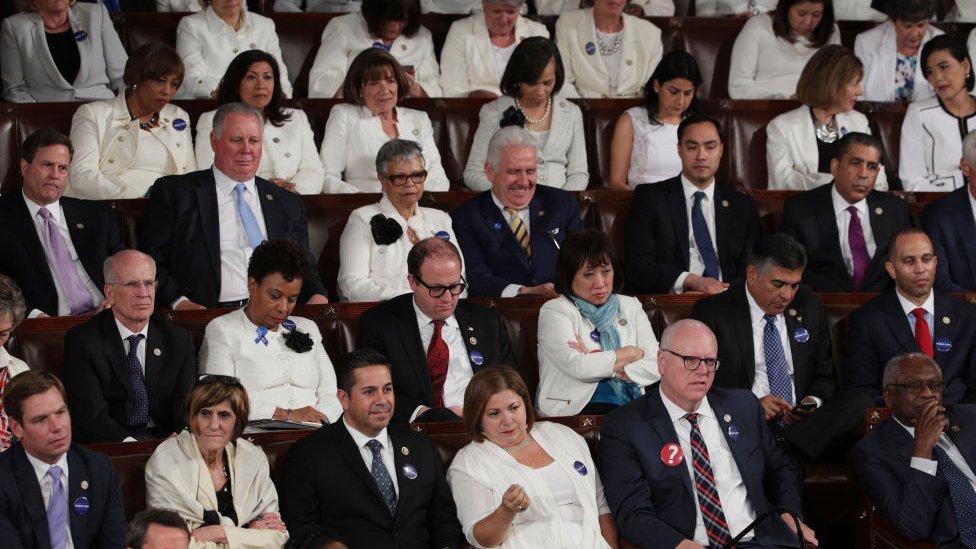 Democrats scowl during Donald Trump's congressional speech.