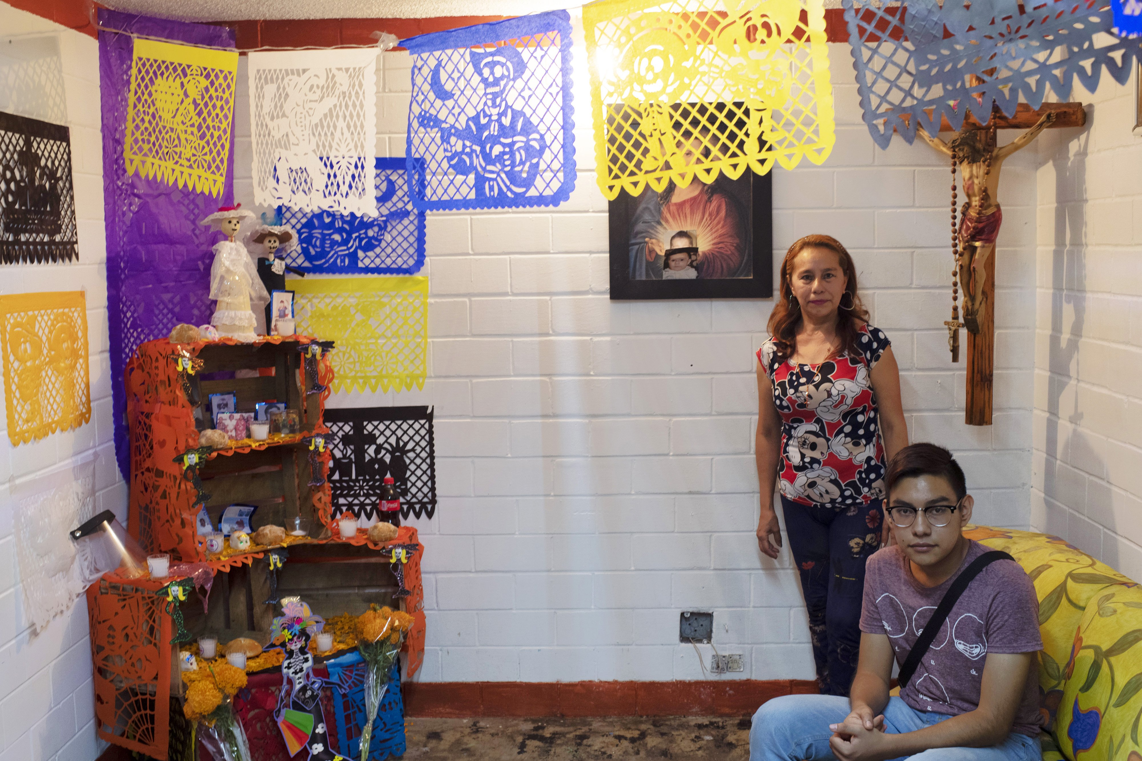 Mayela Alejandra Vela, poses with her 15-year-old son Kevin at the offering at their home, in the Tepito neighbourhood