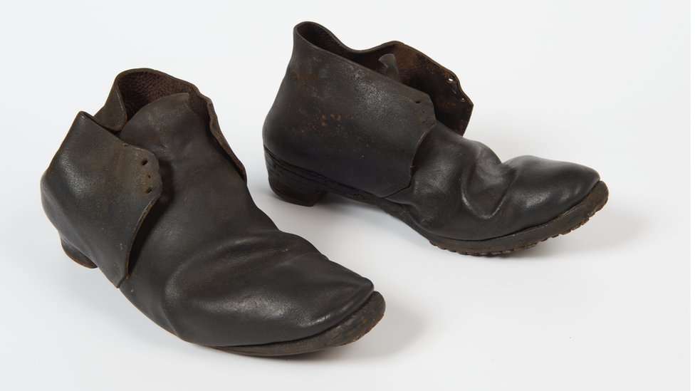 Pair of men's black leather Blucher ankle boots. 1840-49. Found under the floor of old military prison in Weedon Barracks, Northants