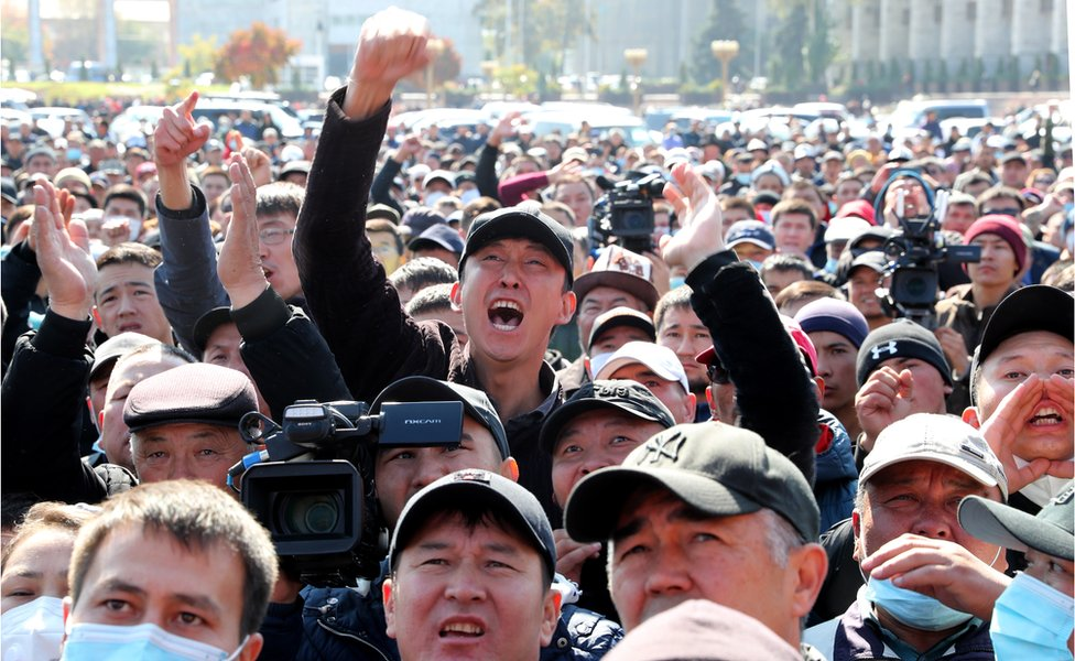 Protesters gather during a rally demanding the impeachment of Kyrgyzstan's President Sooronbay Jeenbekov in the central square of Ala-Too in Bishkek, Kyrgyzstan, 7 October 2020