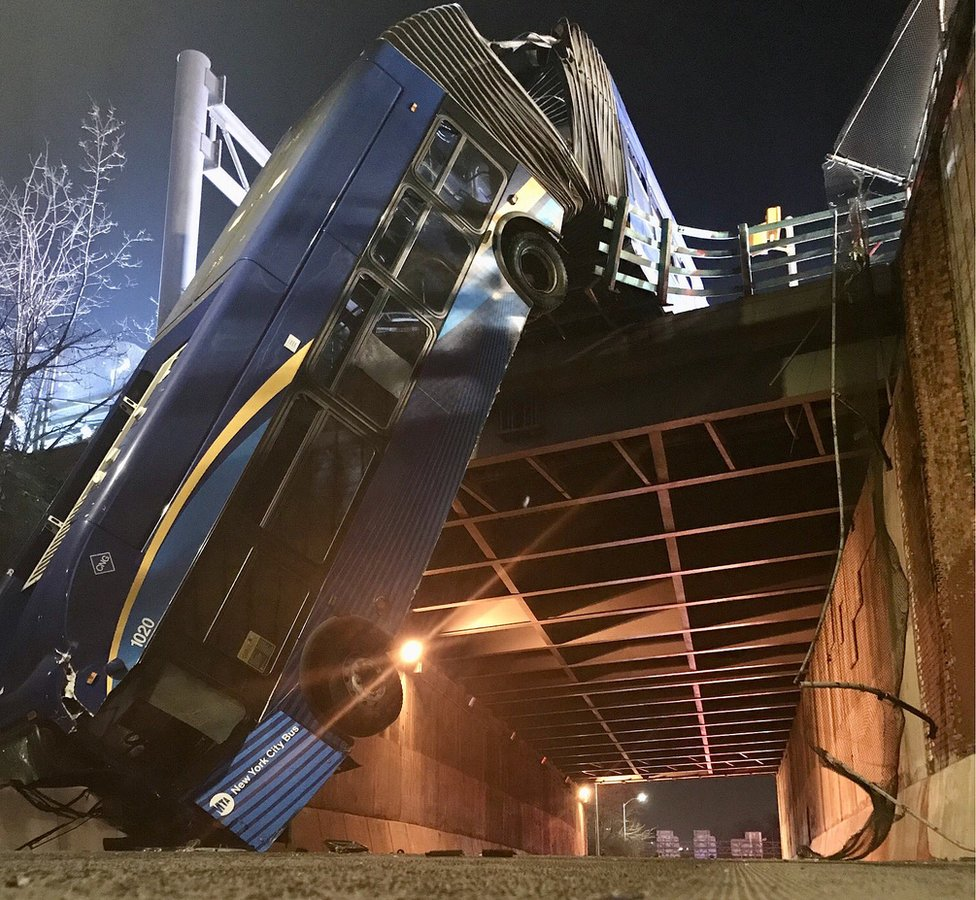 Image from Twitter showing bus hanging from overpass in New York