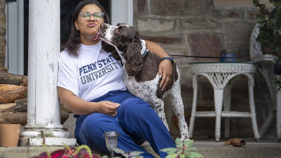 Meryl Daly-Parker, a nurse in East Norriton, Pennsylvania: sitting with her dog