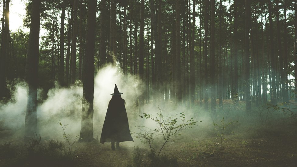 A witch in a dark forest