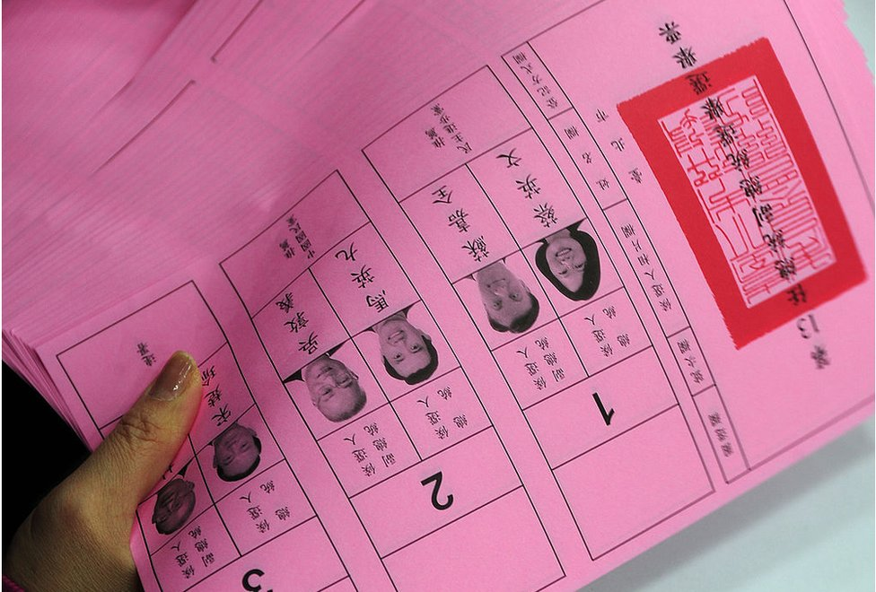 An election official staff counts the presidential elections' ballots at the Taipei City Election Commission on 13 January 2012.