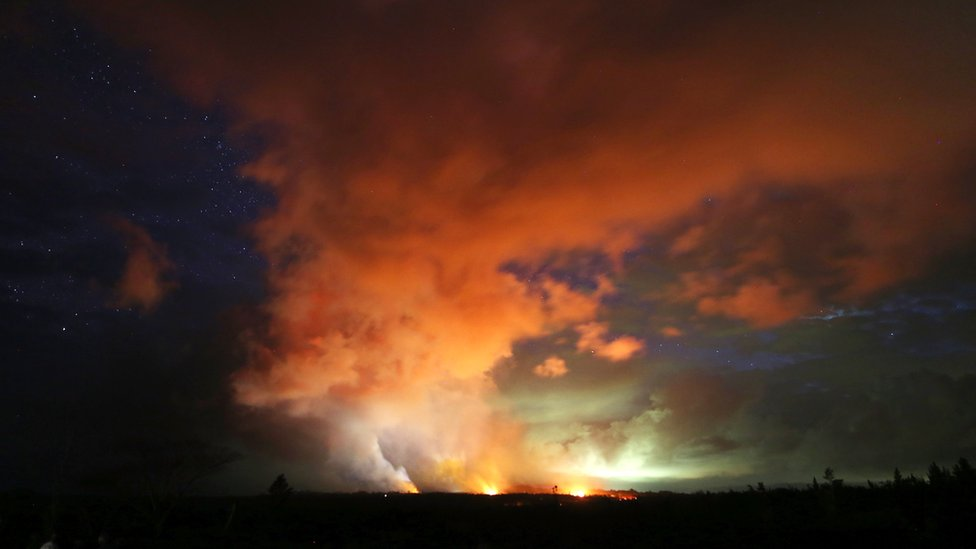 MAY 15: Lava from active fissures illuminates volcanic gases from the Kilauea volcano amidst stars on Hawaii's Big Island on 15 May 2018 in Hawaii Volcanoes National Park, Hawaii.