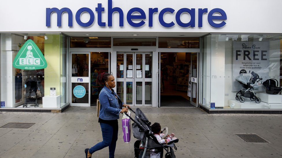 Woman in front of Mothercare store