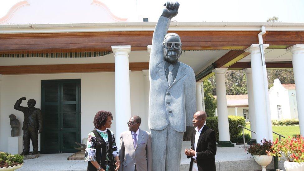 Grace Mugabe, far left with Robert Mugabe, statue and Dominic Benhura, far right