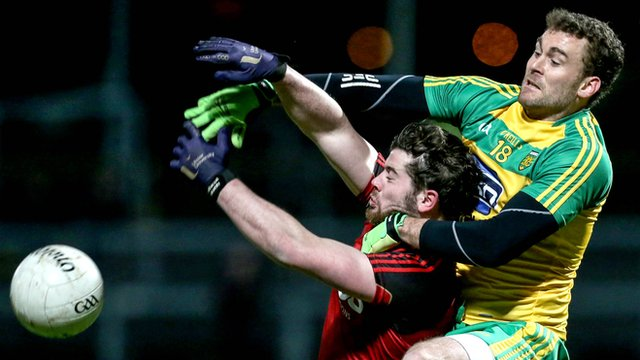 Down's Niall Madine battles with Donegal's Eamon McGee at Pairc Esler