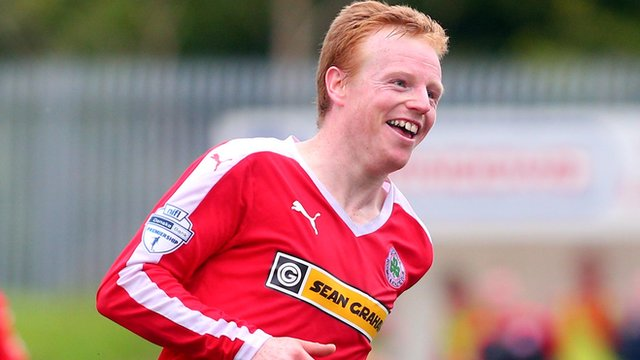Cliftonville captain George McMullan scored the winner against Carrick Rangers at Solitude