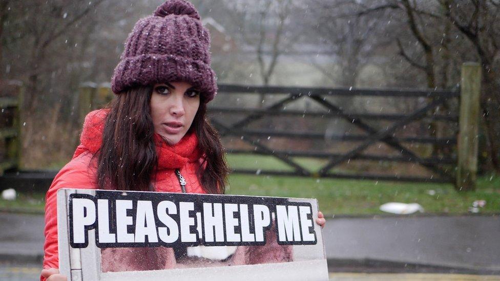 Vegan campaigner holding a placard