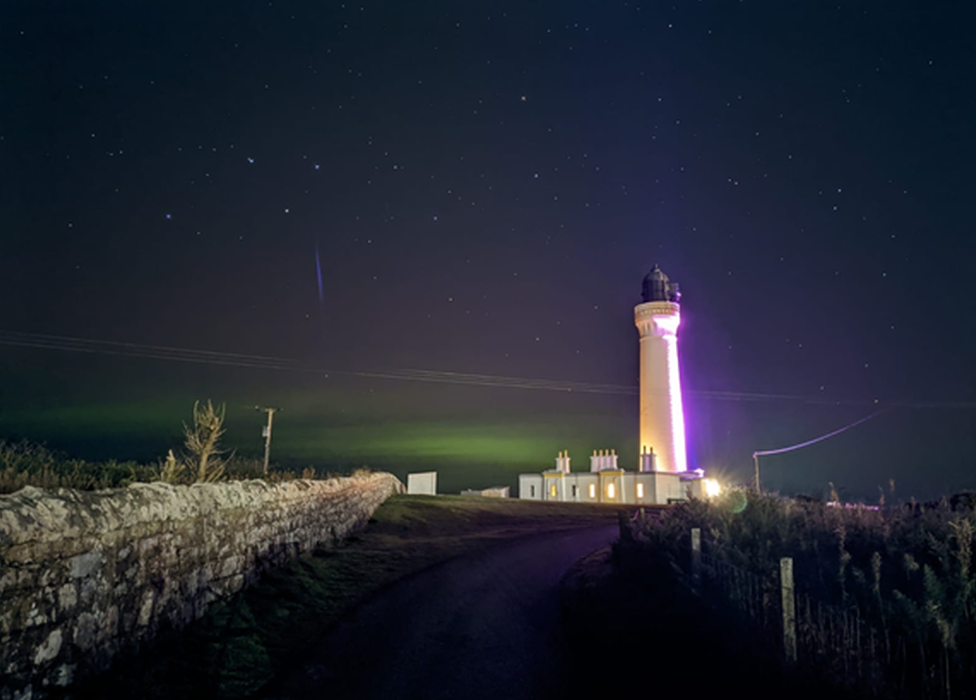 """""""First time using my new phone's night setting mode,"""" says Sean Young from Elgin. """"Caught the aurora at Lossiemouth West beach lighthouse."""""""