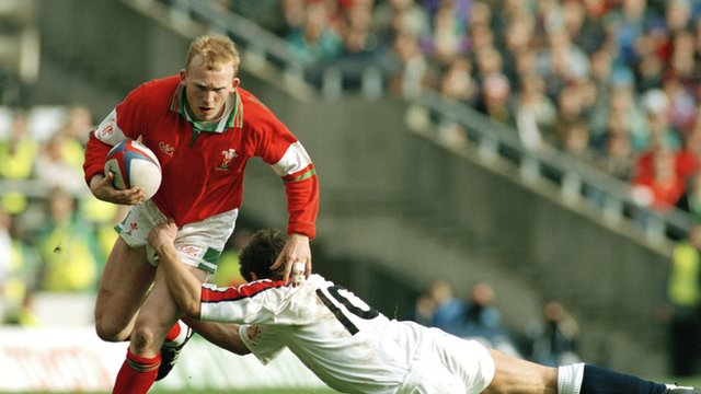 Wales outside-half Neil Jenkins is tackled by Rob Andrew of England in the Five Nations match at Twickenham in March 1994.