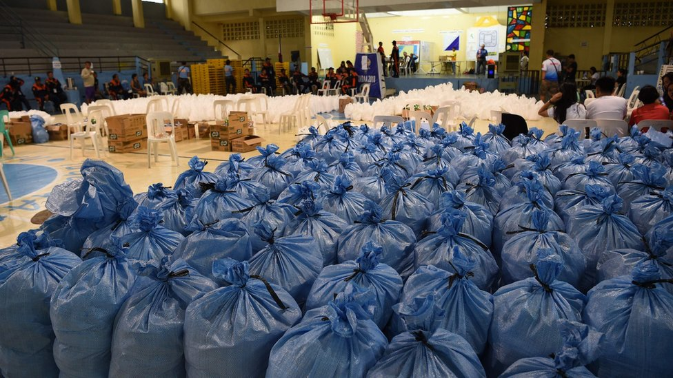 Sacks containing relief food packs to be distributed to typhoon-affected residents, 14 September 2018