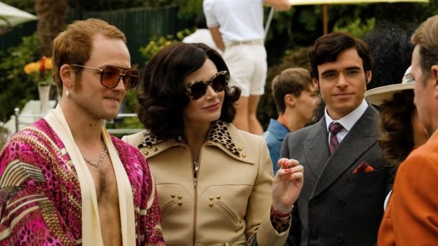 Taron Egerton with Bryce Dallas Howard as his mum Sheila and Richard Madden, who plays Elton's manager John Reid
