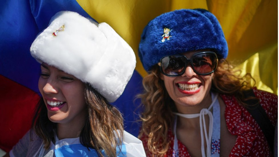 Football fans from Argentina sing songs and enjoy the party atmosphere of The World Cup near Red Square