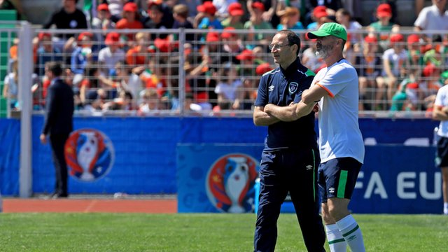 Local children watch on as Republic of Ireland boss Martin O'Neill and assistant Roy Keane take training on Thursday