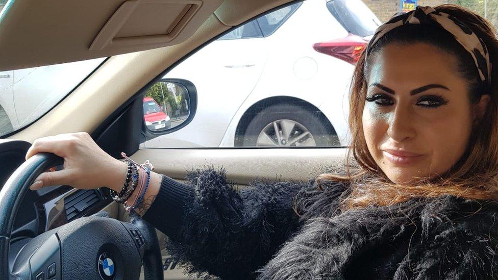 Elena in her car