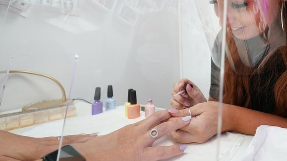 Beautician Alex Smith, 26, does the nails of Jules Aspen, 40, at the Madame Beauty salon in Chirton, North Tyneside, as they reopen to customers on following the easing of lockdown restrictions in England