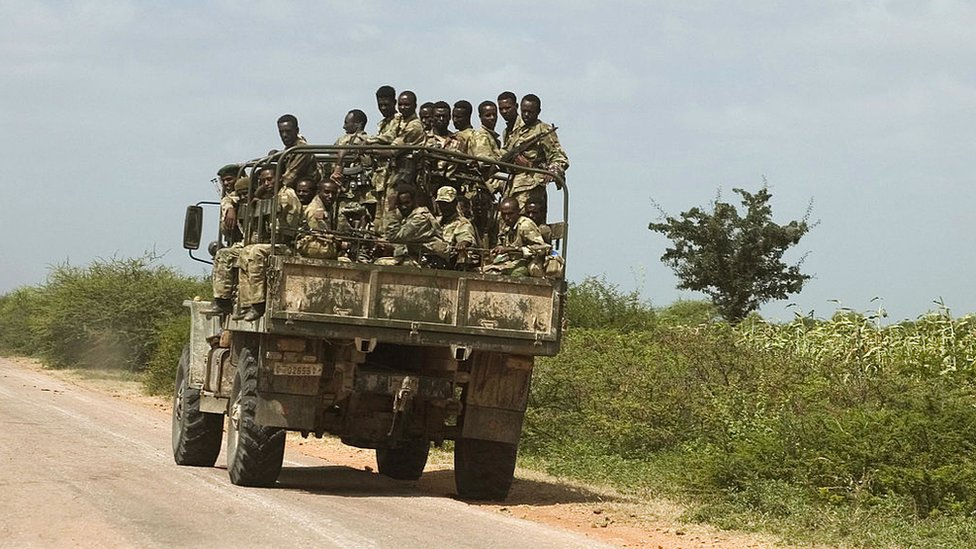 Ethiopian soldiers ride an army vehicle on their way to Mogadishu, 28 December 2006.