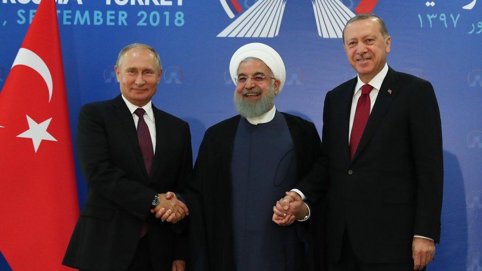 رجب طيب أردوغان وحسن روحاني وفلاديمير بوتين
