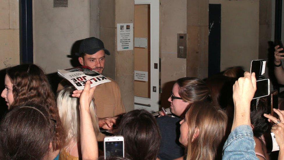 Orlando Bloom signs programmes after finishing a performance of Killer Joe