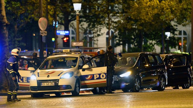 Police officers secure the area after a gunman opened fire on Champs Elysees on April 20, 2017 in Paris, France.